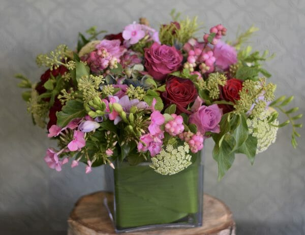 Photo showing a sample of seasonal vase arrangement mixed pink shade colours Kensington flowers. London