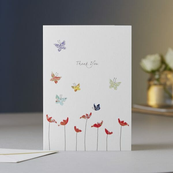 Photo showing a sample image of an Eloise Hall Thank You gift card, of illustrated flowers and butterflies available at Kensington Flowers