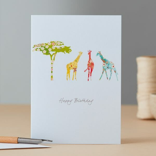 Photo showing a sample of an Illustrated Giraffe & Tree Birthday Card available at Kensington Flowers