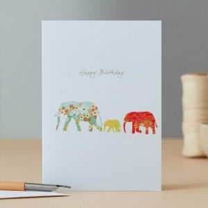 Photo showing a sample image of an Elephant Family Birthday card gift cards available at Kensington Flowers