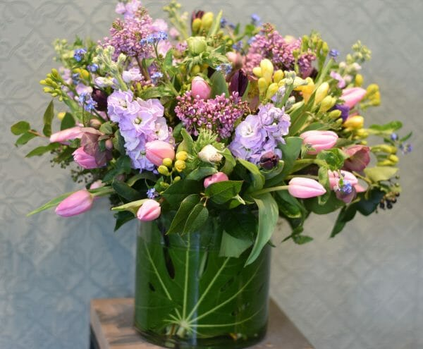 Photo showing a sample of a Scented garden vase arrangement available to order from Kensington Flowers London
