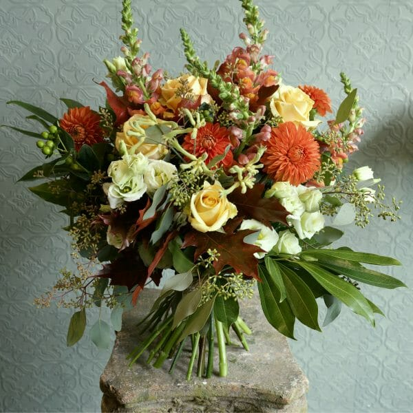 photo showing a sample of a autumanl seasonal rose bouquet available to order from Kensington flowers London