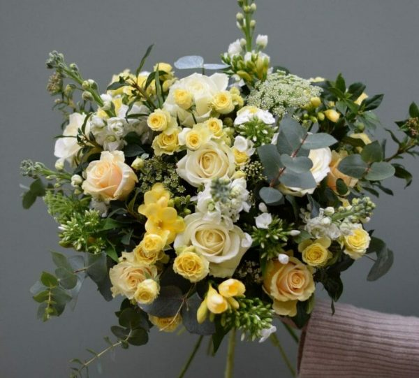 Photo showing a sample of a seasonal rose bouquet in yellow and white Kensington flowers