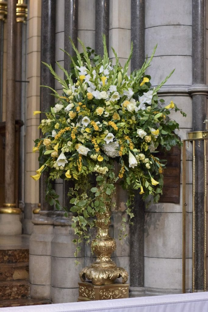 Photo showing a Floral church pedestal display from Kensington flowers