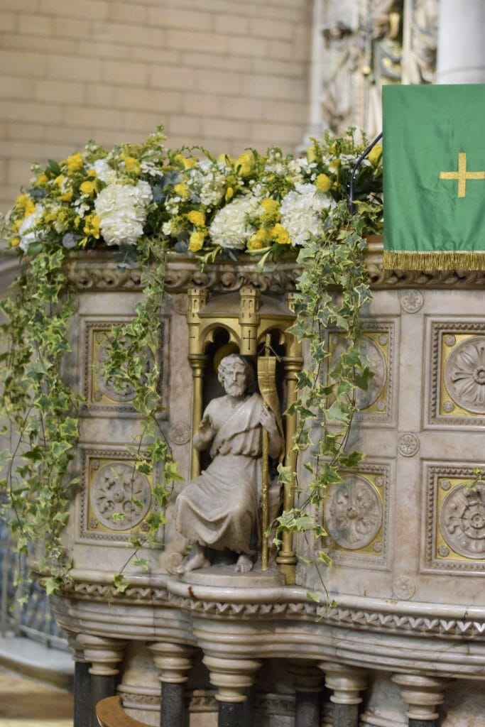 Photo of a Floral church pulpit display, yellow and white flowers from Kensington flowers