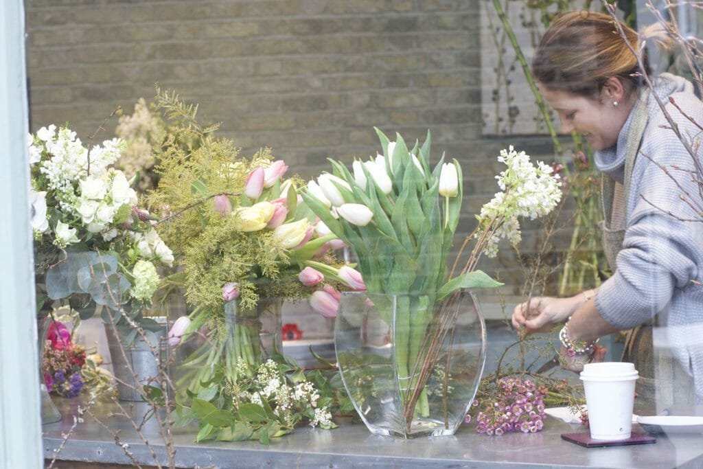 Photo of a Photo of a florist working at Kensington flowers London