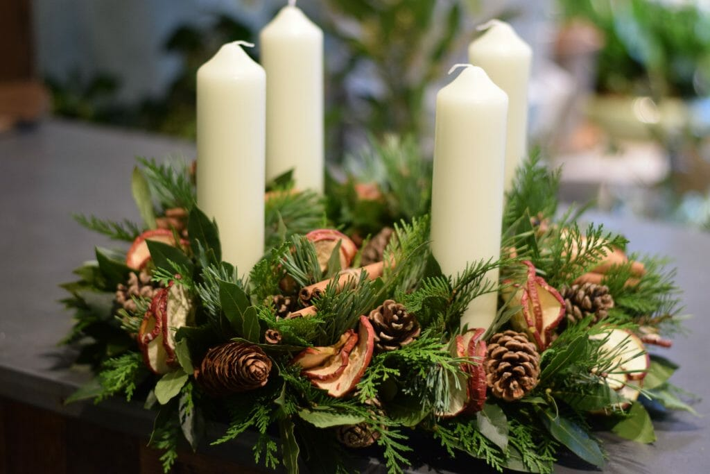 Photo showing a Christmas Advent Candle-arrangement mixed pines, fruits and cones Kensington flowers London