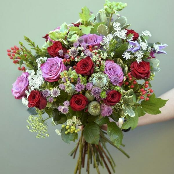 Photo showing a sample of a Seasonal rose bouquet in mix colour available to order from Kensington flowers London