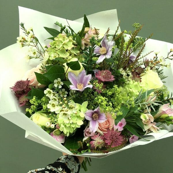 Photo showing a sample of a Seasonal bouquet in pastel shades ,available to order from Kensington flowers London