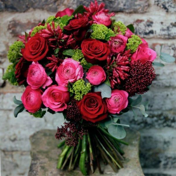 Photo showing a sample of a vivid Seasonal Hand Tied Bouquet Kensington Flowers