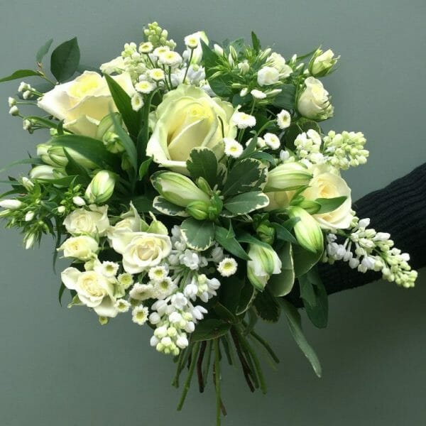 Photo showing a sample of one of the White seasonal rose bouquets, available from Kensington Flowers London