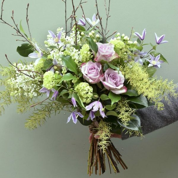 Mauve Roses and clematis seasonal rose bouquet sample