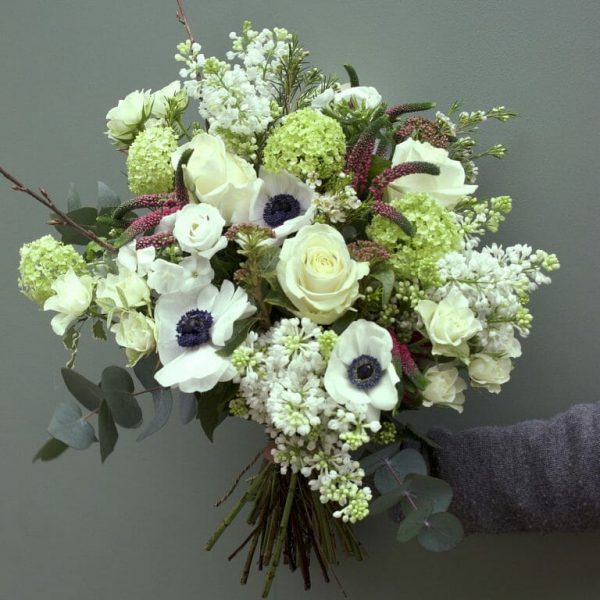 Photo showing a sample Seasonal rose bouquet with anemones available in Spring available from Kensington flowers London