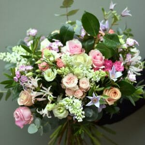 Photo showing a Seasonal rose bouquet in pastel shades available to order from Kensington flowers