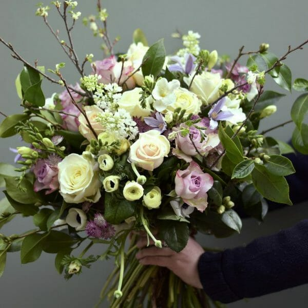 Photo showing a sample of a pastel Seasonal rose bouquet available from Kensington flowers, London