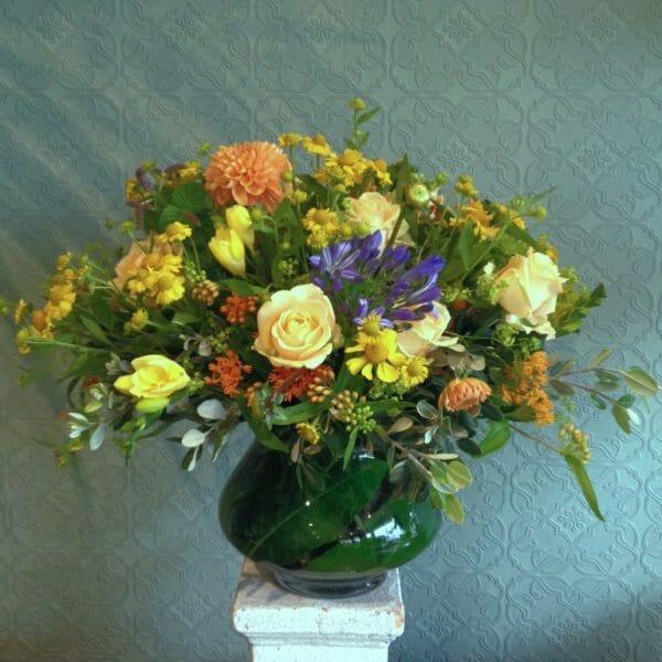 Photo showing a sample of a studio choice florist rose vase arrangement choice, available from Kensington flowers London