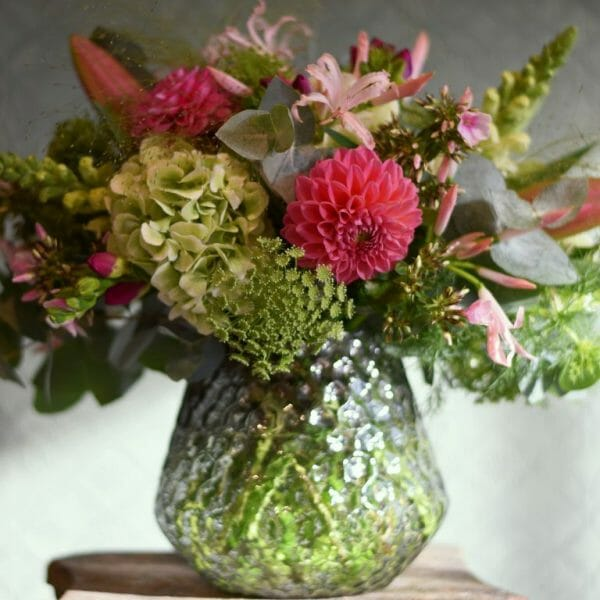 Photo showing a sample of a Studio choice vase arrangement, late summer nerines, hydrangeas and Dahlia pastel colours. Kensington flowers, London